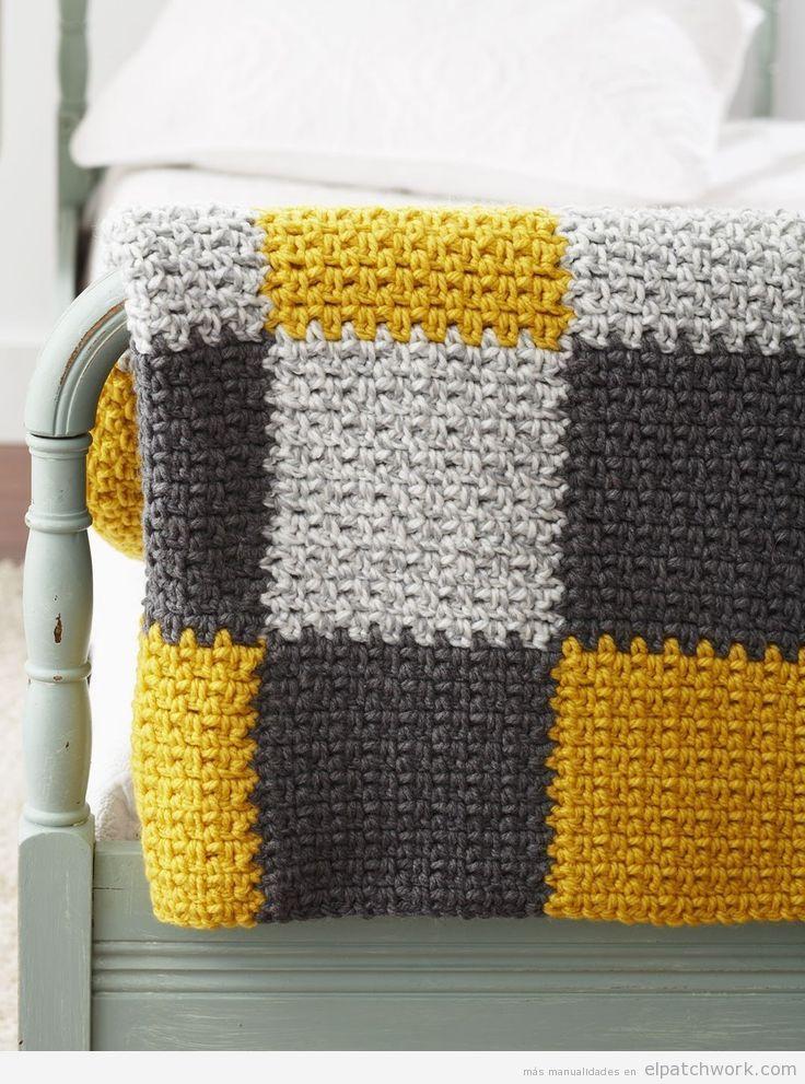 Manta patchwork encima cama